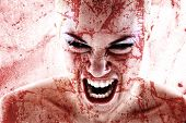 image of freaky  - portrait of a bloodstained  woman - JPG