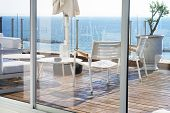 Interior Of A Large Hotel Balcony, Villas. Beautiful Balcony With White Divans. White Interior Conce poster