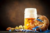 Beer Mugs And Pretzels On A Wooden Table. Oktoberfest. Beer Festival. Selective Focus. Background Wi poster