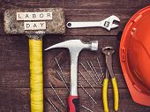 Old Tools And Wooden Letters With The Inscription Labor Day On The Background Of A Vintage, Wooden,  poster