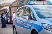 German Police Car Stands On Street. Two Police Officers Controls Traffic. Polizei Is The German Word poster