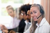 Portrait Of A Happy Young Female Customer Service Executive poster