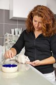 woman feeding domestic rat