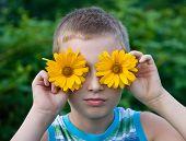 Cute Boy With Flowers On Eyes Having Fun