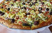 stock photo of klamath  - A Mediterranean Style Pizza with cheese klamath olives artichokes onions red peppers and pesto - JPG