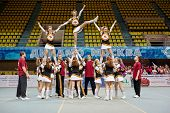MOSCOW - MAR 24:  Cheerleaders girl team performs stunt at Championship and Contests of Moscow in ch