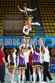 MOSCOW - MAR 24: Cheerleaders team performs stunt at Championship and Contests of Moscow in cheerleading at Palace of Sports Dynamo, March 24, 2012, Moscow, Russia.