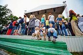 MOSCOW - JUN 23: Unidentified children sit on steps and applaud at concert of Chaif rock-band at VII
