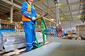 LOBNYA - JUN 7: Workers operates crane-beam in manufacturing workshop at plant of Group of companies Metal Profile, June 7, 2012, Lobnya, Russia.