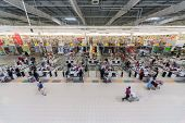 SAMARA - MAY 5: People make purchases in Auchan superstore, on May 5, 2012 in Samara, Russia. French
