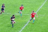 MOSCOW - JUNE 30: Rugby players run at fighting for ball on second stage of European championship on
