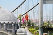 ISTANBUL - JULY 4: Family walk at Bosphorus Bridge in Miniaturk Museum, on July 4, 2012 in Istanbul,