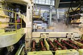 Special pressing machine works in production shop of rolling mill
