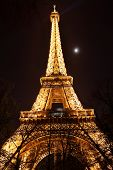 PARIS, FRANCE - April 17: Evening lighting of the Eiffel tower on April 17, 2013 in Paris, France. T