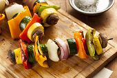 stock photo of kebab  - Organic Grilled Vegetable shish Kebab with peppers mushrooms and onions - JPG