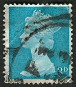 UK-CIRCA 1968:A stamp printed in UK shows image of Elizabeth II is the constitutional monarch of 16