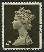UK-CIRCA 1967:A stamp printed in UK shows image of Elizabeth II is the constitutional monarch of 16 sovereign states known as the Commonwealth realms, in Sepia, circa 1967.