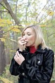 Woman Relieving Asthmatic Attack Using Inhaler
