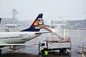 Worker Deices The Wing Of The Plain In Frankfurt Airport At The First Frost