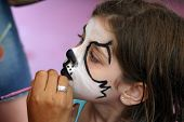 stock photo of face painting  - A Face Painting day for a little girl - JPG
