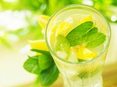 stock photo of condensation  - a glass  water with lemon and mint - JPG