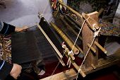 stock photo of handloom  - a Weaver at the old loom in china  - JPG