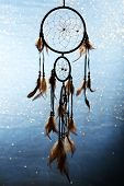 image of dream-catcher  - Beautiful dream catcher on blue background with lights - JPG