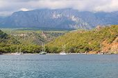 Boats anchored near the coast in Mediterranean sea (Kemer, Turkey)