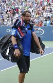 Professional tennis player Marcos Baghdatis leaving stadium after match loss at US Open 2013