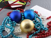 Christmas Ball And Pearls On A Plate, New Year Holiday Card
