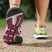 stock photo of soles  - Sole of running shoes while jogging sport training or workout - JPG