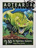 A stamp printed in New Zealand shows Te Ngarara-huarau giant first lizard