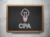 Finance concept: Light Bulb and CPA on chalkboard background