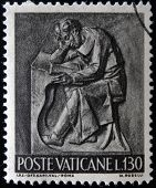 A stamp printed in Vatican shows Bas reliefs of arts and crafts student