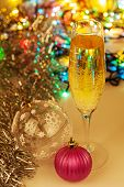 Glass Of Champagne And Christmas Decorations On New Year Background