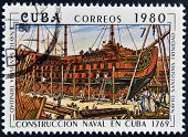 A stamp printed in Cuba shows construction of a Cuban naval vessel
