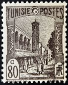 TUNISIA - CIRCA 1923: stamp printed in Tunisia shows Mosque and street Tunis circa 1923