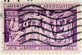 Stamp printed in USA shows the Section of Frieze Supreme Court Room American Bar Association