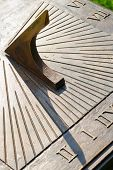 foto of sundial  - Closeup of classic decorative bronze sundial outdoors - JPG