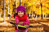 Happy Little Girl On Bicycle