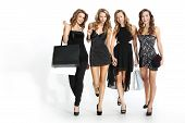 stock photo of black heel  - Group of four friends in sexy dresses with purchasing bags on a white background - JPG
