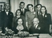 GANSERNDORF, AUSTRIA, CIRCA 1930s: Vintage photo of elderly couple and family at their wedding anniversary, Ganserndorf, Austria, circa 1930s