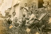 GANSERNDORF, AUSTRIA, CIRCA 1930s: Vintage photo of farmers family in front of their house, Ganserndorf, Austria, circa 1930s
