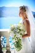Young beautiful bride with a bouquet