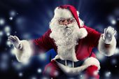 Traditional Santa Claus posing over dark background. Christmas.