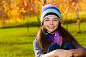 image of 11 year old  - Close portrait of nice smiling 11 years old girl wearing blue purple hat and scurf