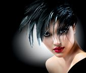 Fashion Art Girl Portrait. Punk Style Model. Vogue Style. Glamour Woman with Black Hair and Red Lips over Black Background