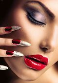 Fashion Beauty Model Girl. Manicure and Make-up. Nail art. Beautiful Woman With Red Nails and Luxury