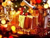 Christmas And New Year Holiday Table Setting with Champagne. Celebration. Place setting for Christma