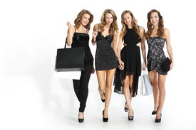 image of going out business sale  - Group of four friends in sexy dresses with purchasing bags on a white background - JPG